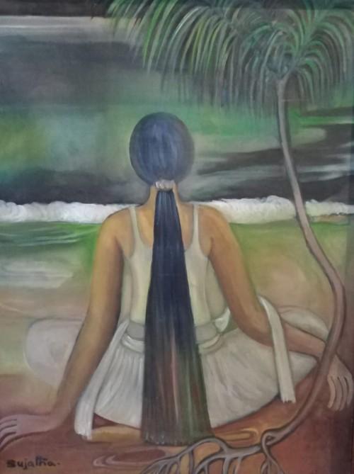 Village girl sitting on the beach